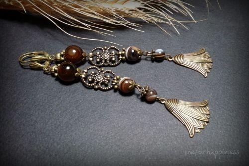 Бронзовые серьги - лотосы с коричневым агатом