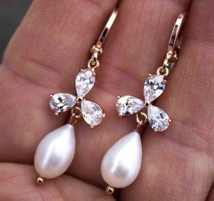 Позолочені сережки з рідкісними перлинами краплями