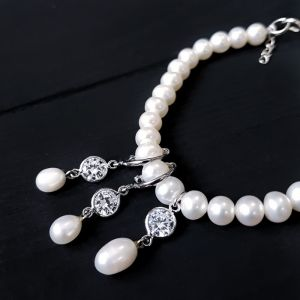 Прикраси ручної роботи Комплект з натуральних перлів та кристалів браслет сережки