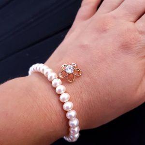 Браслет з натуральних перлів з позолоченим кулоном