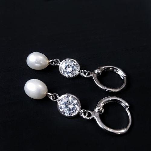 Сережки з натуральними перлами та кристалами циркону