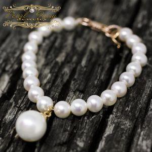 Браслет з розкішних натуральних перлів у позолоті