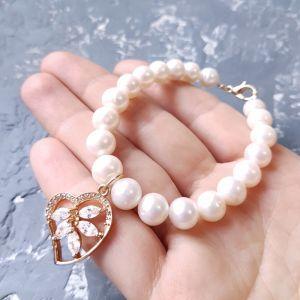 Браслети ручної роботи Браслет з натуральних перлів з позолоченою підвіскою
