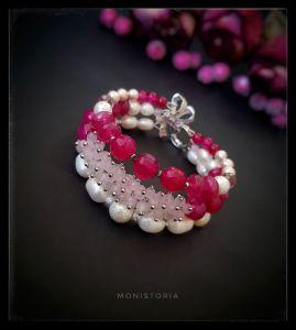Рожевий браслет Браслет з рожевого кварцу, топазу, перлів та агату.