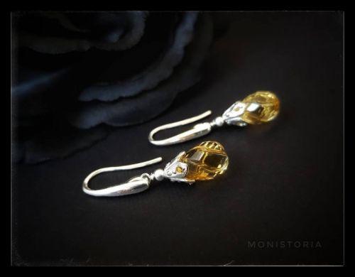Серебряные серьги с резным цитрином