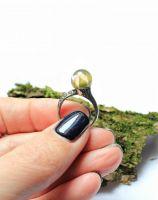 Кольцо с розой в сфере