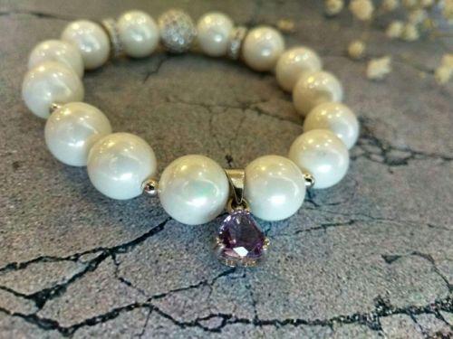 Браслет з натуральних перлів зі срібною підвіскою 925 проби.