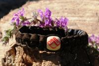 Плетеный кожаный браслет со славянским оберегом Лельник