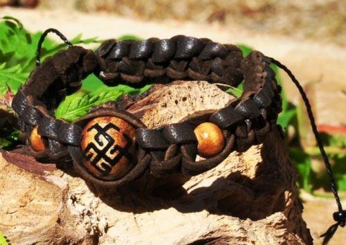 Плетеный кожаный браслет со славянским оберегом Сварожич