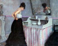 Жінка біля туалетного столика