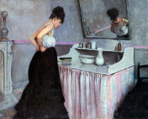 Женщина у туалетного столика