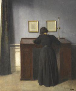 Хаммерсхей Вильгельм Ида, стоящая за рабочим столом